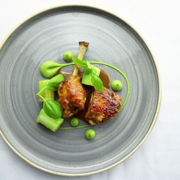 Chicken leg braised in peanut butter jus with broccoli and toasted sesame puree%2C broccoli stem by Kareem Roberts