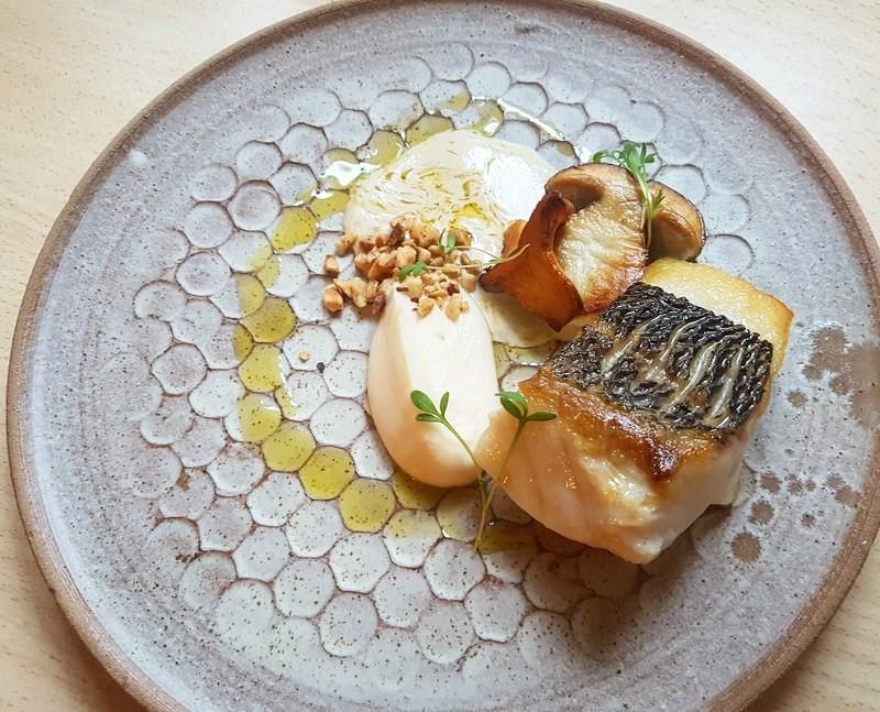 Sea bass%2C cauliflower puree%2C hazelnut%2C buttered mushrooms%2C fish and leek velouté and olive oil...