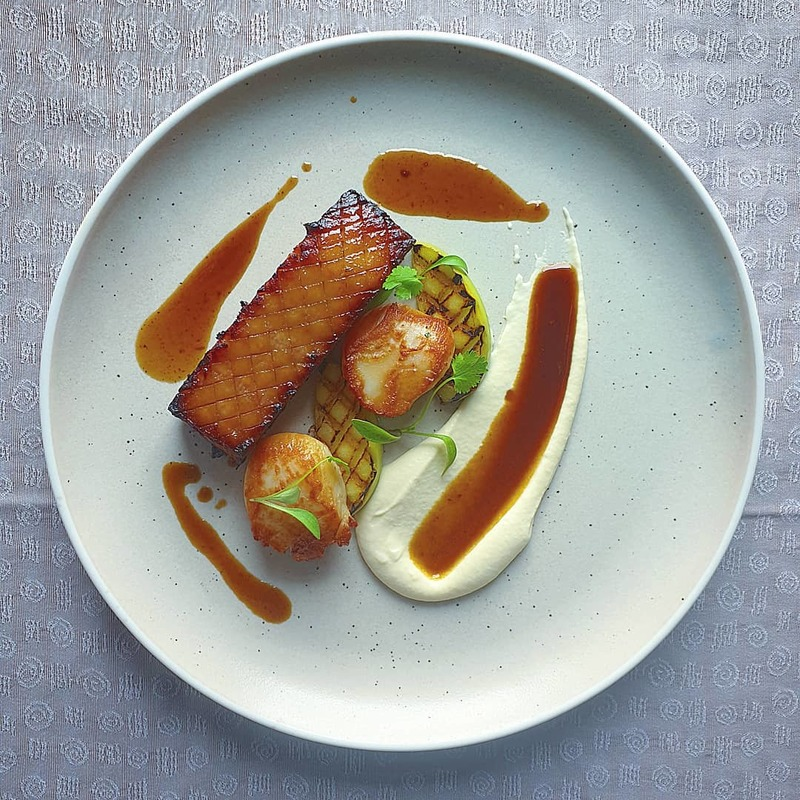 https://www.thestaffcanteen.com/public/js/tinymce/plugins/moxiemanager/data/files/00 July 2019 Insta images/Brown sugar glazed pork belly. Seared scallops%2C grilled apples%2C smoked celeriac puree%2C jus..jpeg