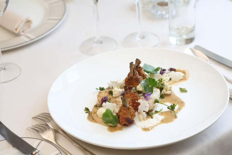 09 40 27 498 Fresh roast plaice confit chicken wings with caramelised cauliflower Alexander buds.