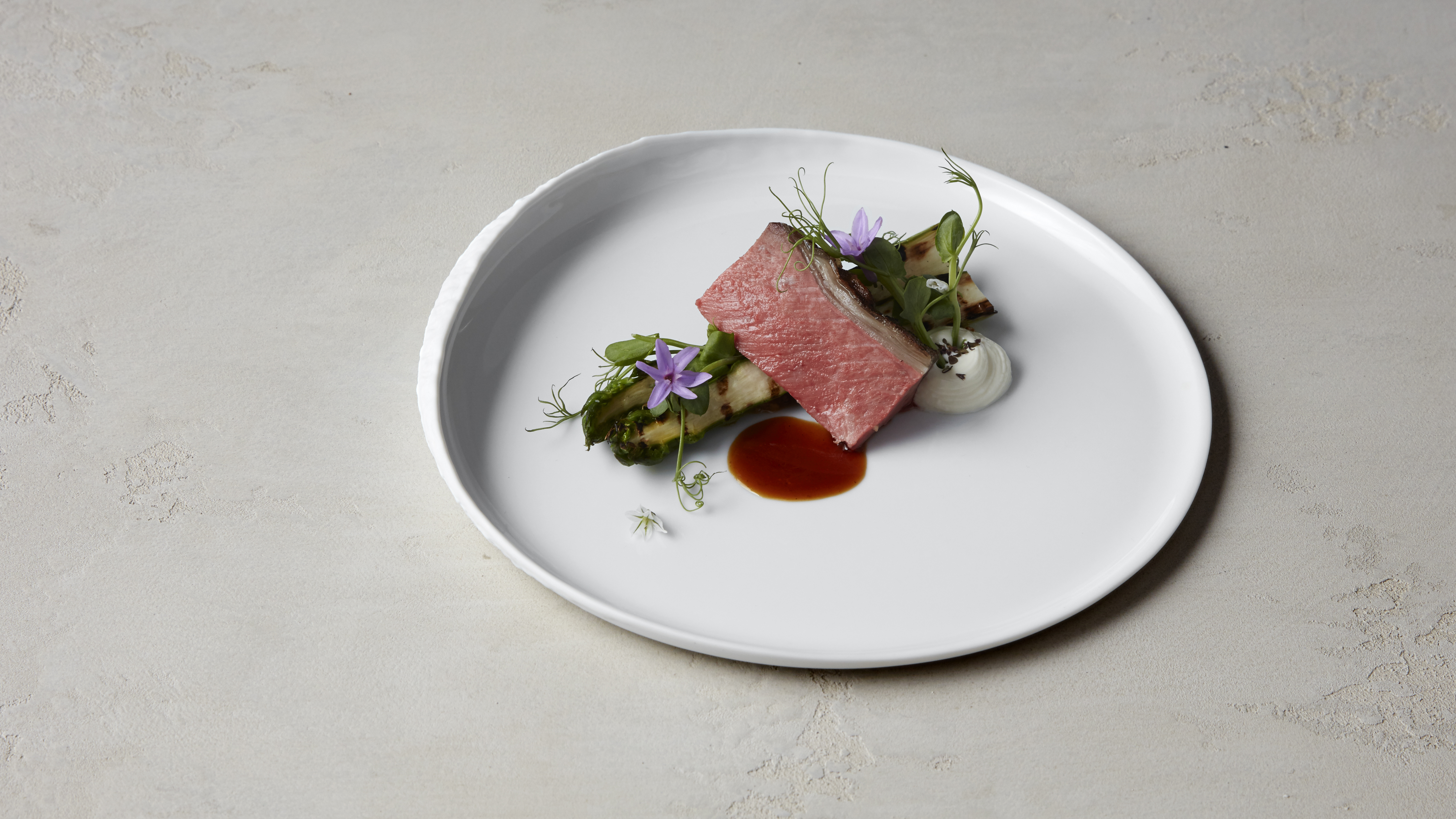 Barbecued organic Herdwick lamb, charred asparagus, savoury pine nut praline by chef Luke Selby, Hide Above