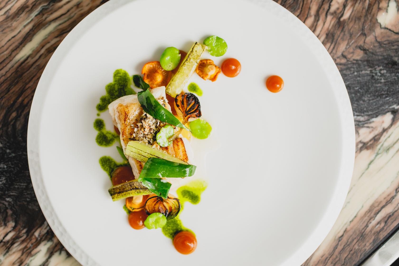 Roast wild halibut, broad beans, sea beet and lovage by Tom Shepherd, head chef at Adam's Restaurant, Birmingham