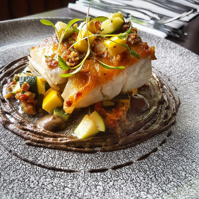 Seared cod, roasted aubergine puree, courgettes, and bacon salsa by chef Kareem Roberts, chefs to follow on Instagram, food pics, social media, The Staff Canteen, Instagram Top Ten
