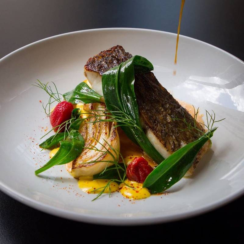 Stone bass, saffron fondant, smoked fennel, sea aster and fish broth by chef George Tannock, food pics, top chefs to follow on Instagram