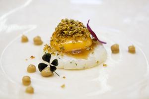 Squid Tartare with liquid egg yolk%2C onion and kaffir consommé   small 2