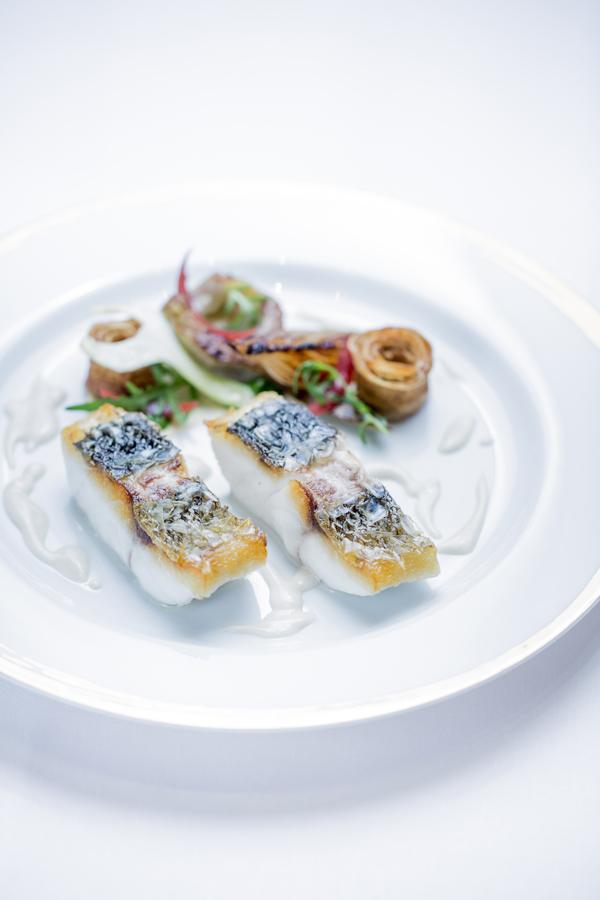 Restaurant Le Meurice Alain Ducasse 'ikejime' line caught sea bass on the scale%2C artichokes%2C rocket salad low res